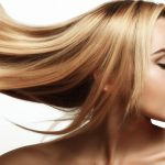 portrait of a beautiful and young blonde with long groomed hair