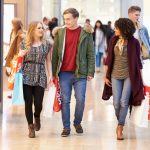 33469480 - group of young friends shopping in mall together