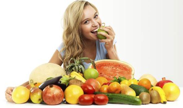 woman-eating-vegetables-and-fruit-553148